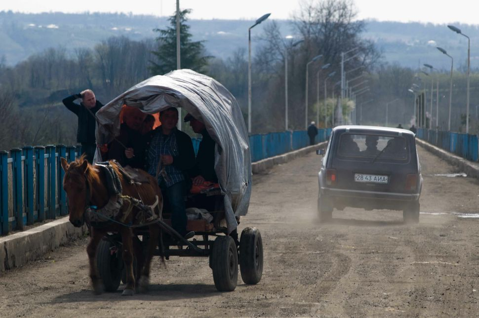 Abkhazians crossing the bridge at Ingur into Abkhazia in a horse cart