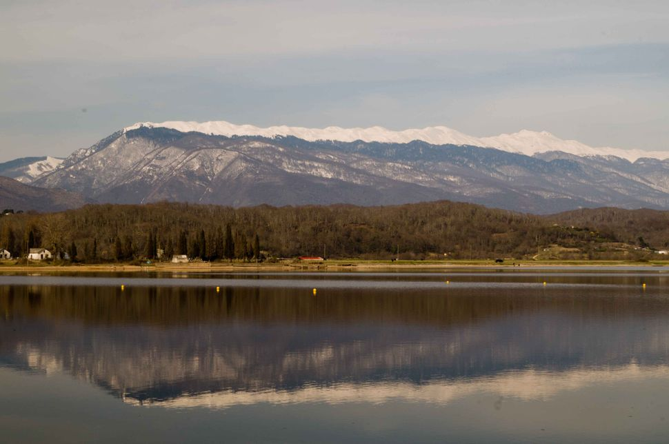 Snowy mountains reflecting in a lake