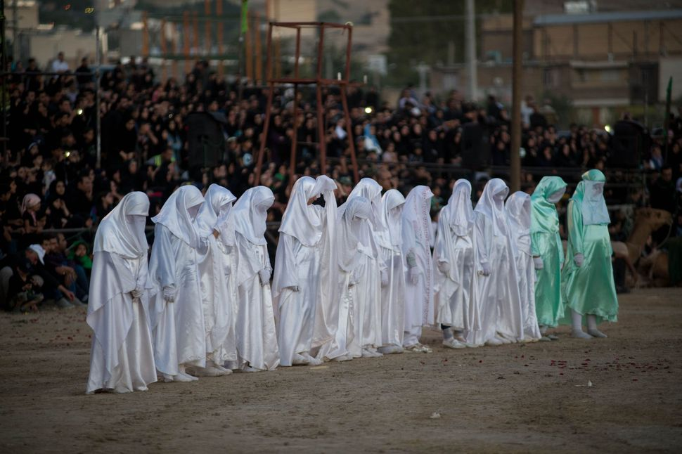 Girls dressed in white symbolising angels coming for the bodies of Imam Hussein and his dead followers