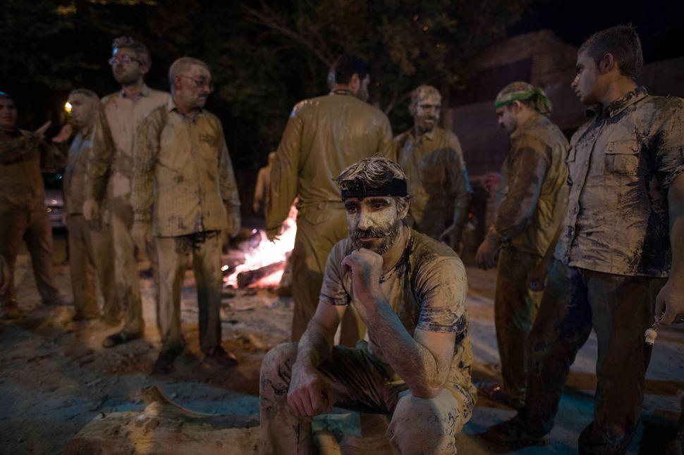Drying men around fire, Khorramabad
