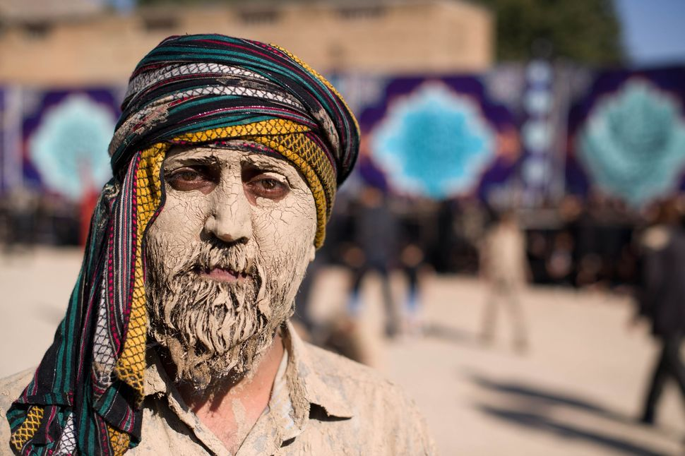 Portrait of man with mud-caked face, Khorramabad