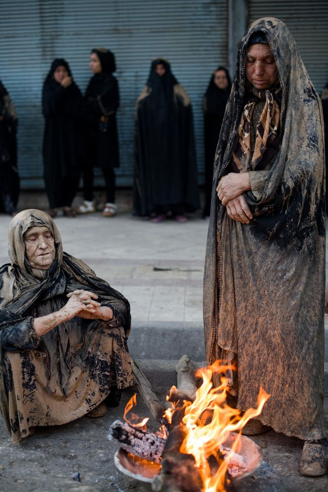 Women warming up by the fire, Khorramabad