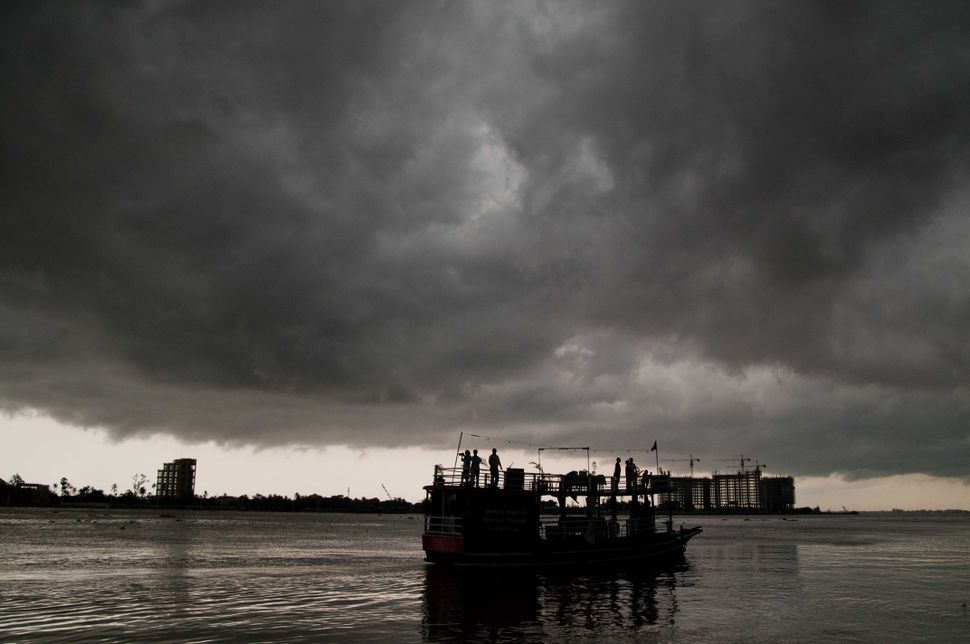 Boat in the storm on the Mekong