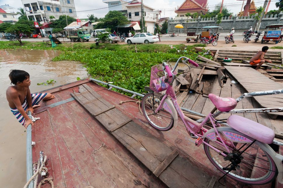 Boy climbing the ferry, Phnom Penh