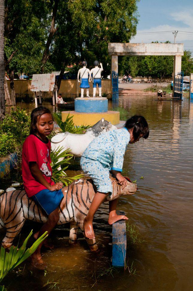 Flooded school, girls playing, Preak Leap