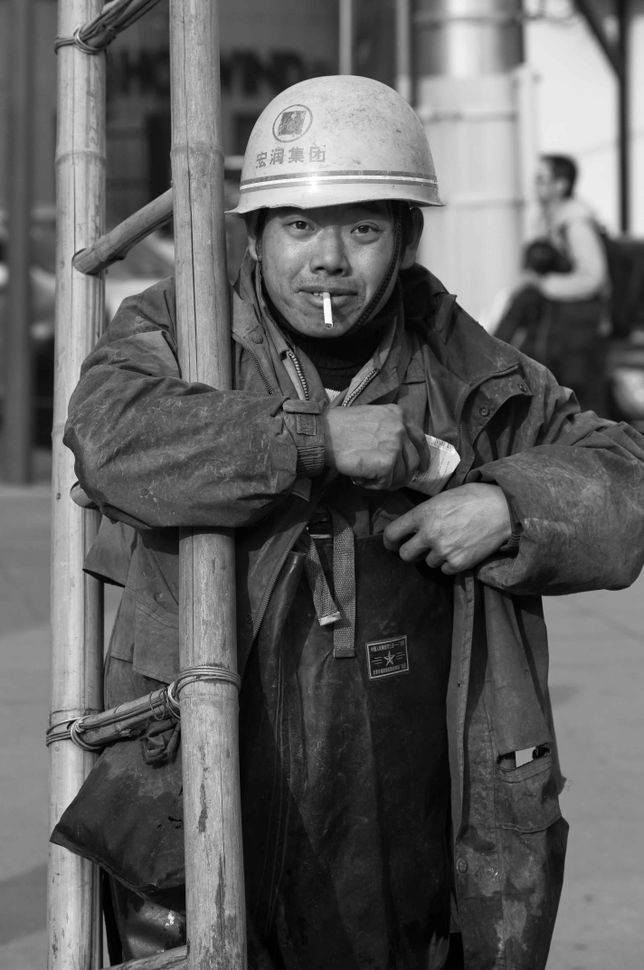Worker with a ladder, Shanghai