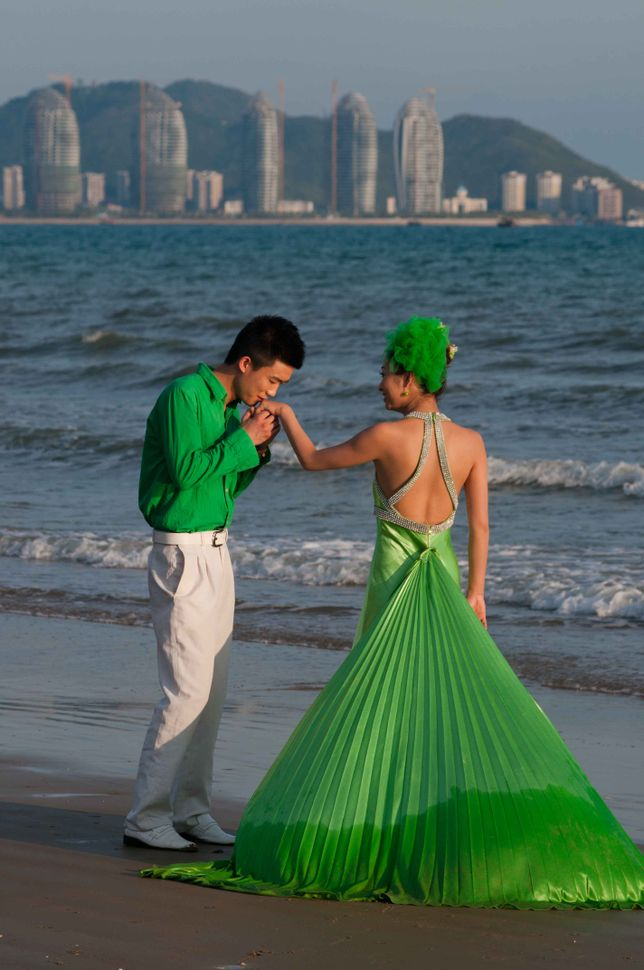 Couple in green on the beach, Sanya
