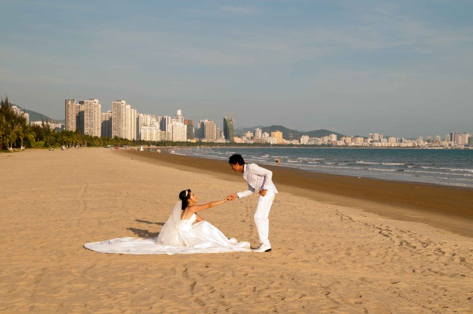Couple in white on the beach, Sanya