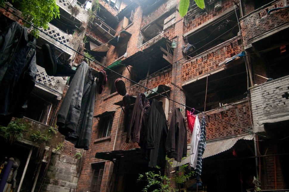 Hanging clothes out to dry in condemned building