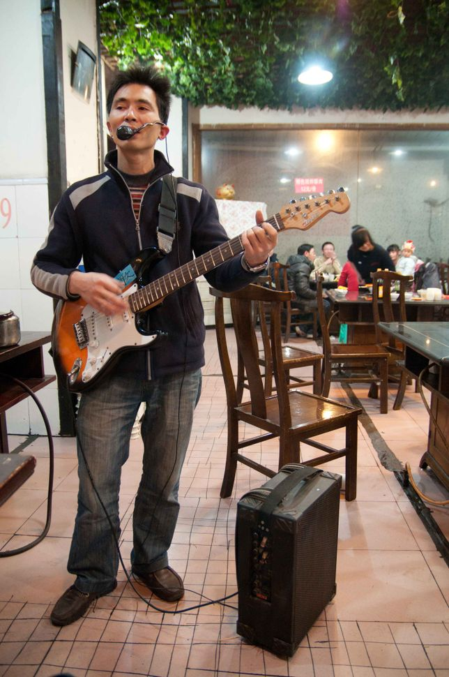 Roving minstrel in hotpot restaurant