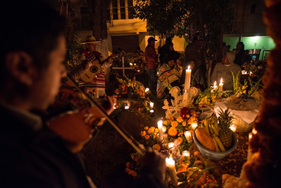 Mariachis playing for the departed loved ones, Tzintzuntzan