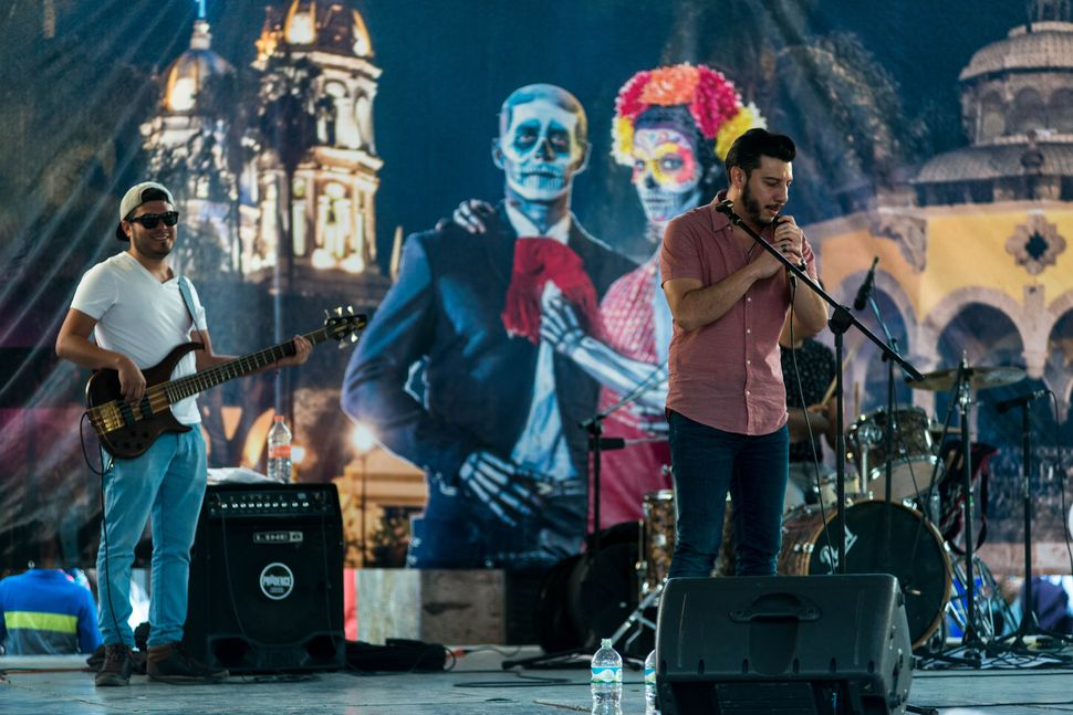 Rock concert with Dia de muertos theme background, Guadalajara