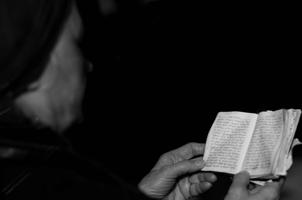 Woman reading the bible in church, Tbilisi