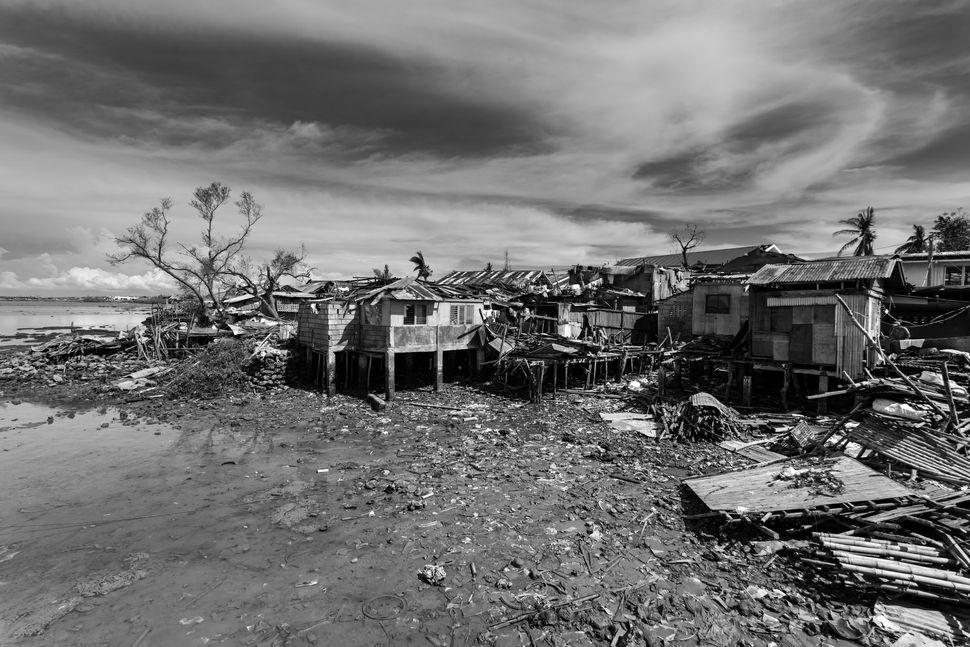 Destruction in poor area near Boko City pier