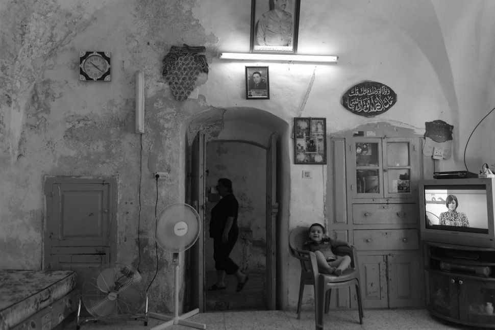 Interior of a Palestinian home (with Saddam portrait) adjoining the Jewish compound