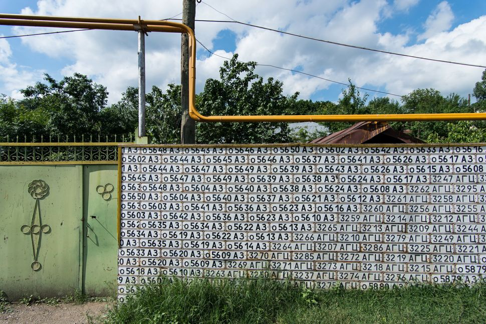 Street wall made of Azeri license plates