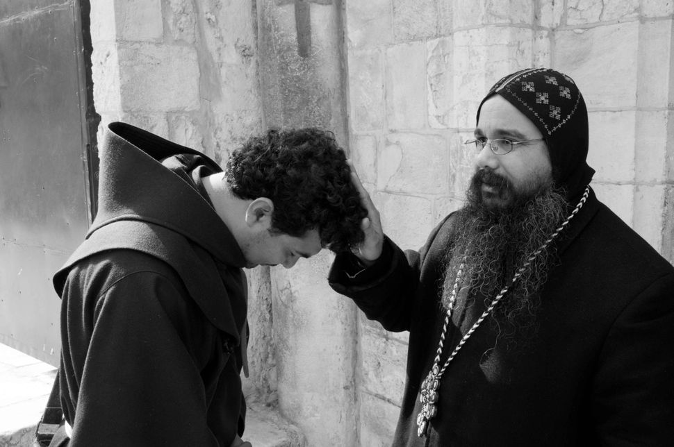 Coptic priest blessing a Catholic padre