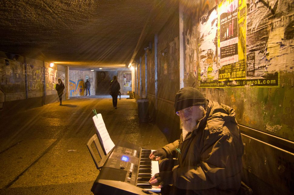 Ex-clarinetist of Kiev Philharmonic playing electric keyboard in a Central Bus Station tunnel Jerusalem