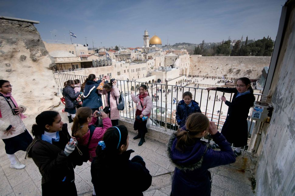 Jewish schoolgirls posing with the Wailing Wall and the Dome of the Rock in the background