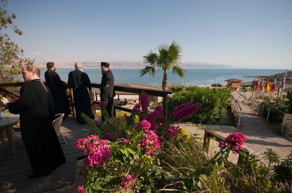 Romanian Orthodox priests at the Dead Sea