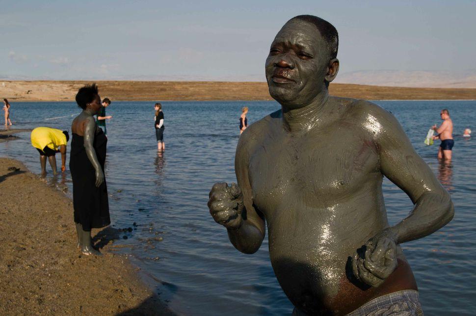 Ugandan bathers at the Dead Sea