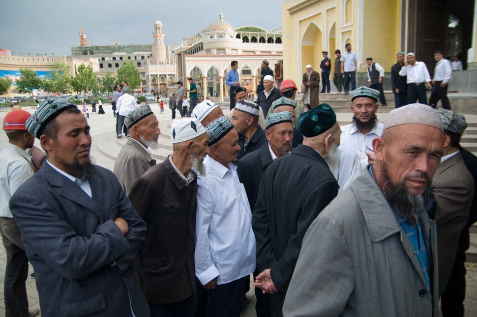 Kashgar residents in front of the Id Kah Mosque, 2