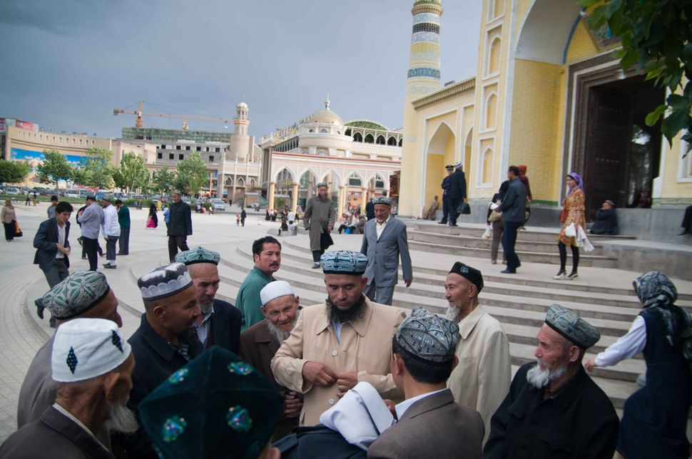 Kashgar residents in front of the Id Kah Mosque