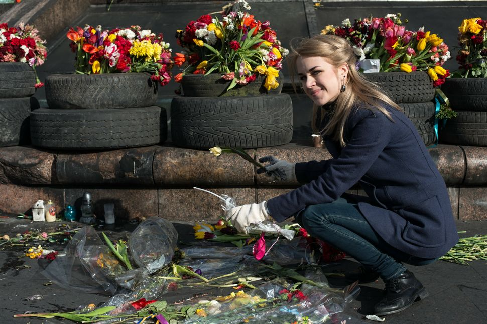 49 - Girl (Anya) removing dead flowers