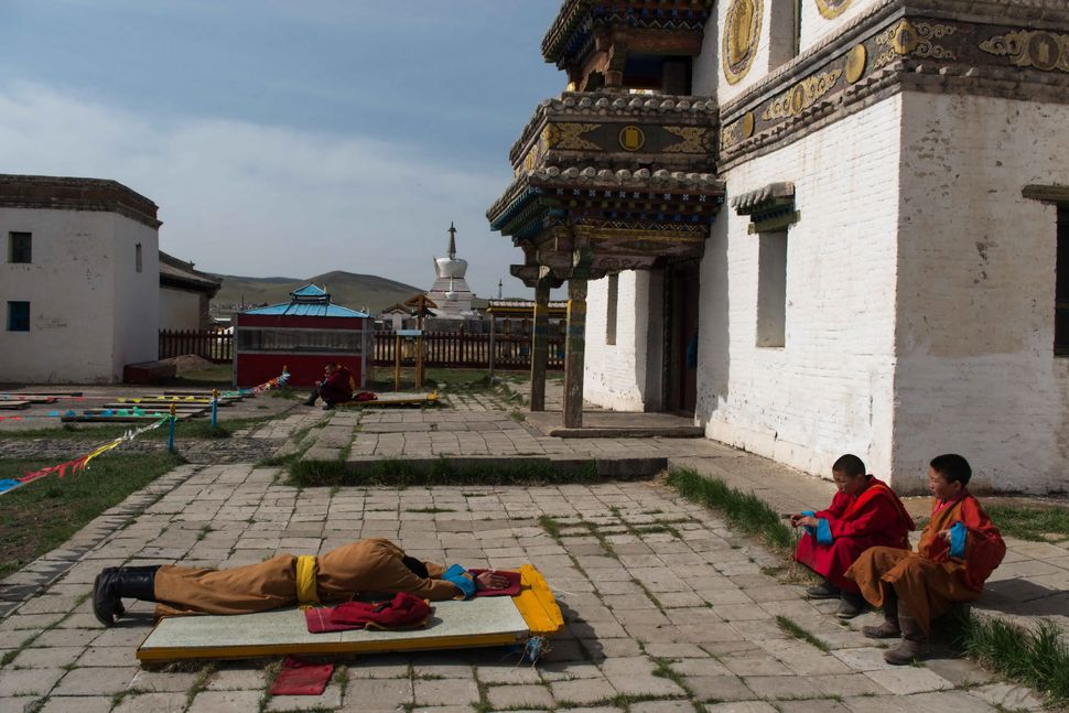 Erdene Zuu Monastery - Young monk in morning prayer