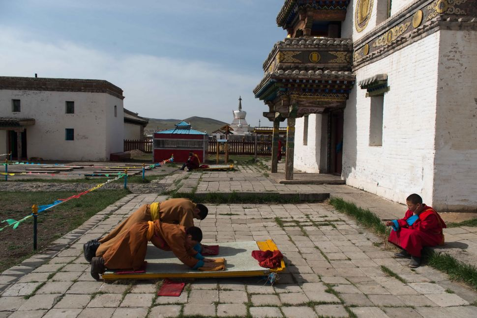 Erdene Zuu Monastery - Young monks in morning prayer