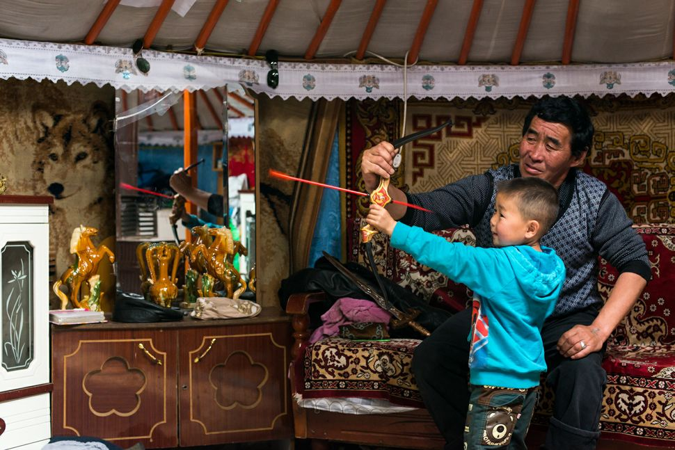 Ulan Bator - Ger district, father teaching son to shoot with bow and arrow 2