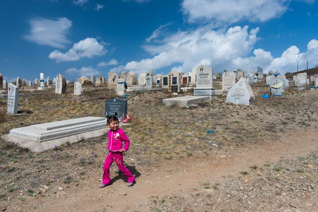 Ulan Bator - Ger district - Girl walking along cemetery