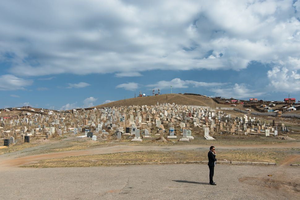 Ulan Bator - Man with a cellphone near cemetery 3