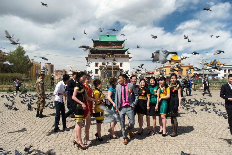 Ulan Bator - University graduates in front of Gandan Monastery
