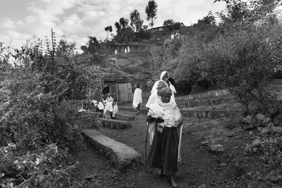 Believers coming from the holy water springs, Lalibela