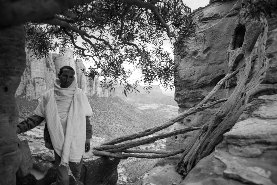 Priest outside the Abuna Yemata Guh church, Tigray