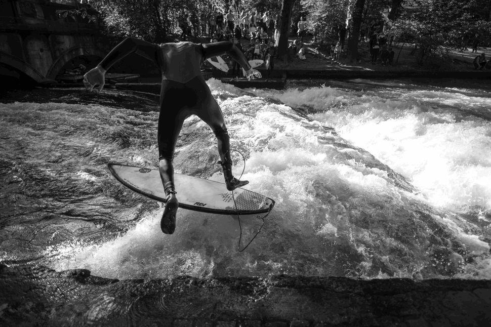 Surfing on the Eisbach, Munich, October 2018
